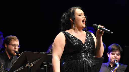 SWU alumna Britney Fernandez performs at the annual Presidential Gala in 2019 on SWU's campus.